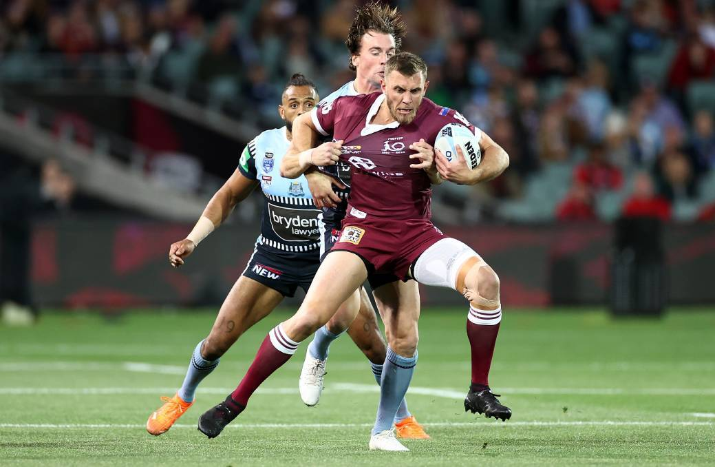 Queensland centre Kurt Capewell is manhandled by NSW opposite Clint Gutherson in State of Origin 1 of Wednesday night, but it was the former who was one of the game's best players. Picture: GETTY IMAGES