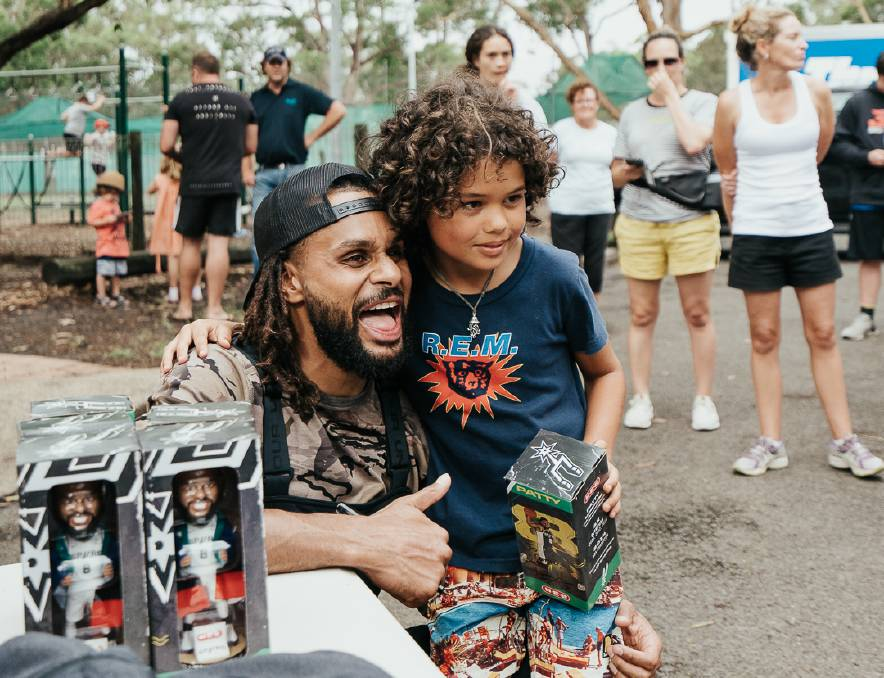 Patty Mills visited the south coast earlier this year to visit fire-affected regions. Picture: Luke Currie-Richardson