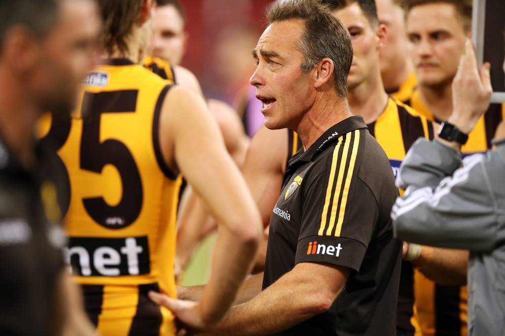 Hawks coach Alastair Clarkson speaks to his team during last Sunday's match against Melbourne at Giants Stadium, Sydney. Clarkson's spray about umpiring earlier this season appears to have had an effect. Photo: Mark Kolbe/Getty Images
