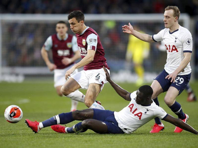 Burnley (in maroon) take on Tottenham shortly before the EPL's COVID-19 shutdown.